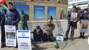 in the cage on palestinina prisoners day