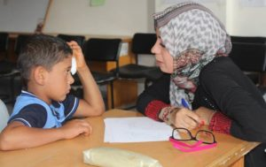 A social worker counsels a child in Gaza
